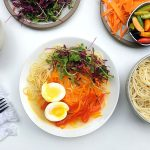 Hot Veggie Noodle Bowl with broth, eggs and microgreens
