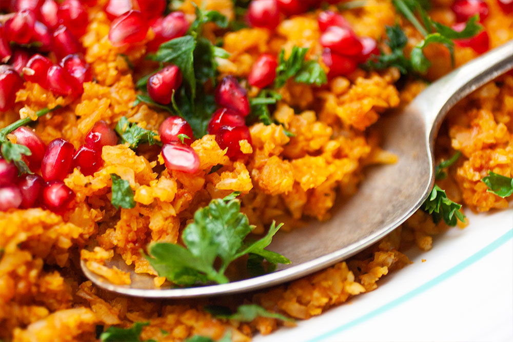 Yellow Cauliflower Rice with Pomegranates
